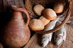 bigstock-Wine-jug-with-bread-and-fish-49877780-1024x683